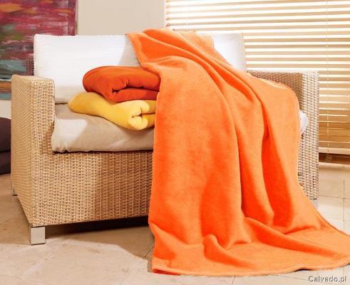 Pomarańczowe i żółte koce - do kupienia www.calvado.pl (cena 219 zł)