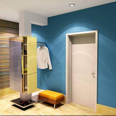 Filar w przedpokoju jest osłonięty konstrukcją z płyt g-k i zabudowany płytkimi szafkami (na przykład na buty, czapki, szaliki). W podobny sposób można zagospodarować także słup w sypialni - również tam przydadzą się szafki.